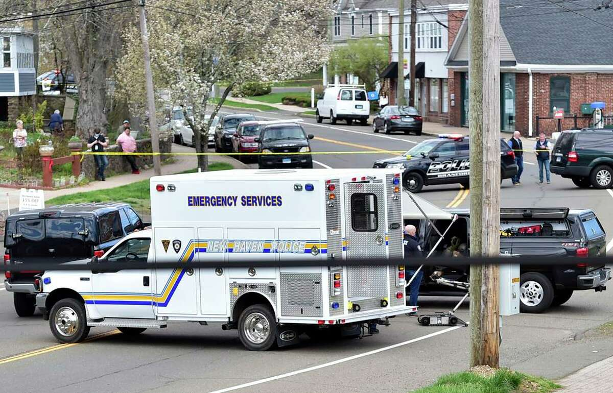 Branford, Connecticut -Tuesday, April 13, 2021: New Haven Police Emergency Services truck set up approximately one block from an active shooter sceneTuesday afternoon on Main Street near Bradley Street in Branford.