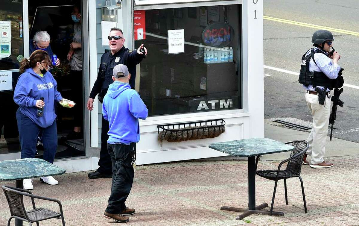 Branford, Connecticut -Tuesday, April 13, 2021: Branford Police evacuate customers from P & M Fine Foods italian deli at 401 Main Street in Branford approximately one block from an active shooter sceneTuesday afternoon on Main Street in Branford.