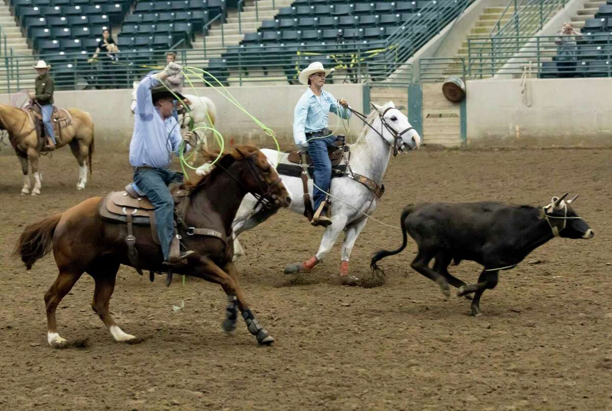 Cord Kohleffel and Josh Debord from Brazos county participate in the Clash of the Counties at the Montgomery County Fair & Rodeo, Tuesday, April 13, 2021, in Conroe. An estimated 112 teams participated in this year's event.