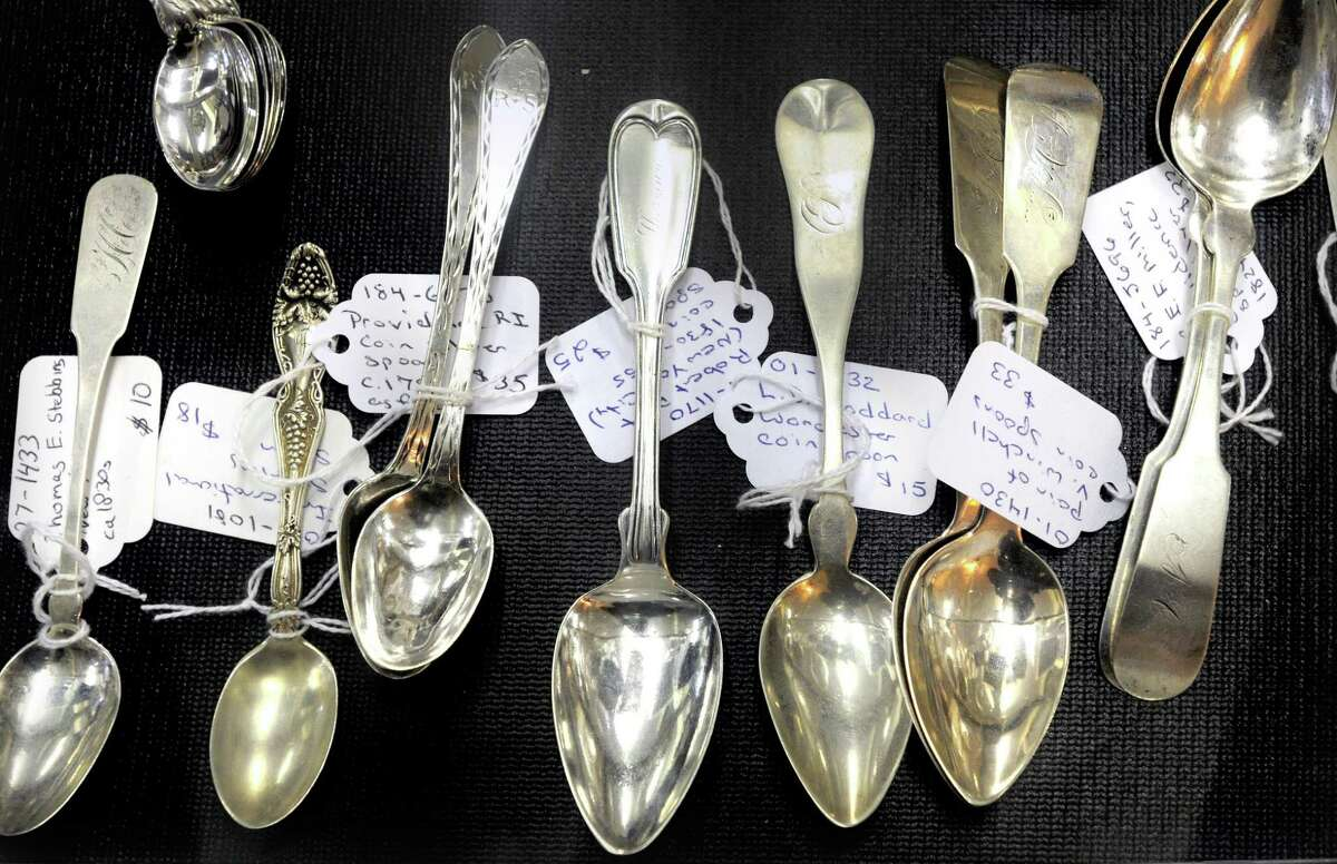 Antique sterling silver and coin silver spoons photographed at The Trove antique store on the Boston Post Rd. in Old Saybrook.