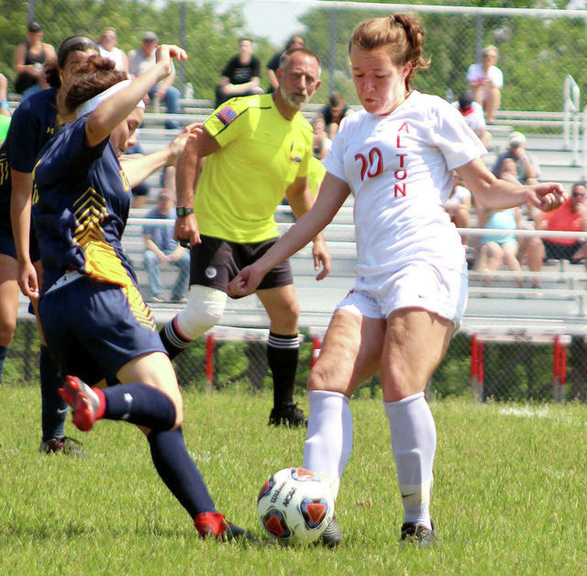 Sydney Brunaugh of Alton, right, scored a first-half goal in the Redbirds' season opener Tuesday at Belleville East. The teams battled to a 1-1 tie through regulation and overtime before East emerged with a 2-1 victory on penalty kicks. Brunaugh is shown in a 2019 game against O'Fallon.