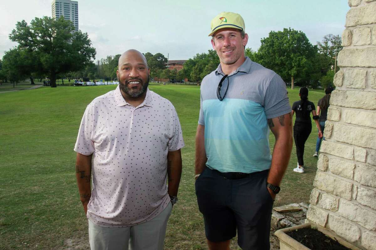 Bun B, left, and Owen Daniels at the Lucille's 1913 inaugural golf tournament and dinner at Hermann Park Golf Course in Houston on April 12, 2021.