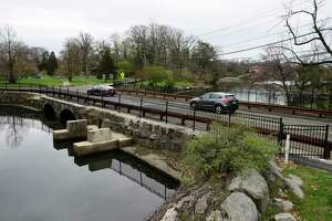 Traffic passes over the Davis Avenue bridge in Bruce Park in Greenwich, Conn. Monday, April 12, 2021. The Department of Public Works will be replacing the bridge and will necessitate a road closure, likely to start around May 1 and then end prior to Sept. 1, with construction taking place six days a week.
