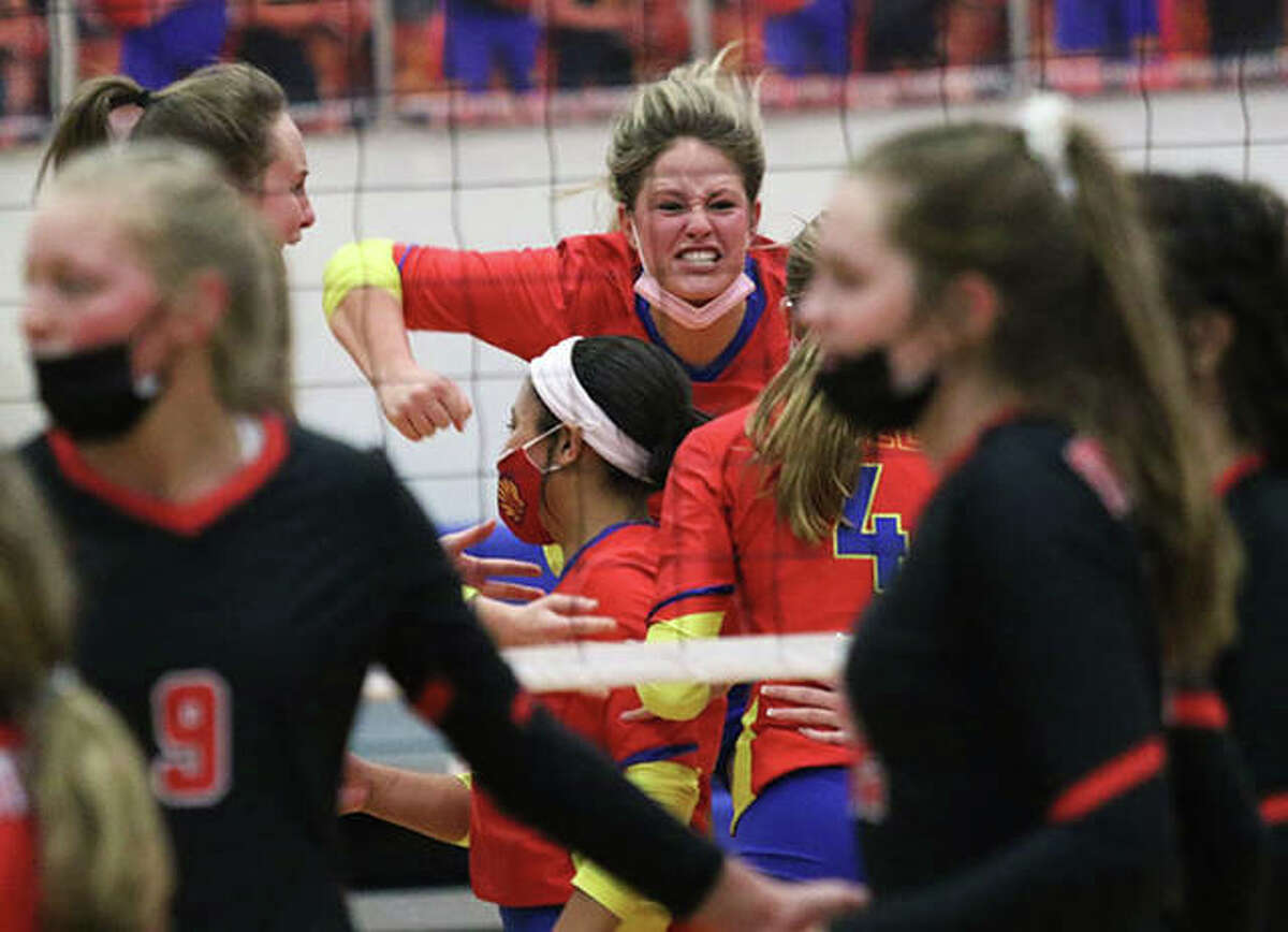 Roxana's Darcey McGuire (middle) reacts after serving set point in a March 22 match against Staunton in Roxana. McGuire is one of six Shells seniors playing their final prep match at Milazzo Gym Tuesday night in a victory over Metro-East Lutheran.