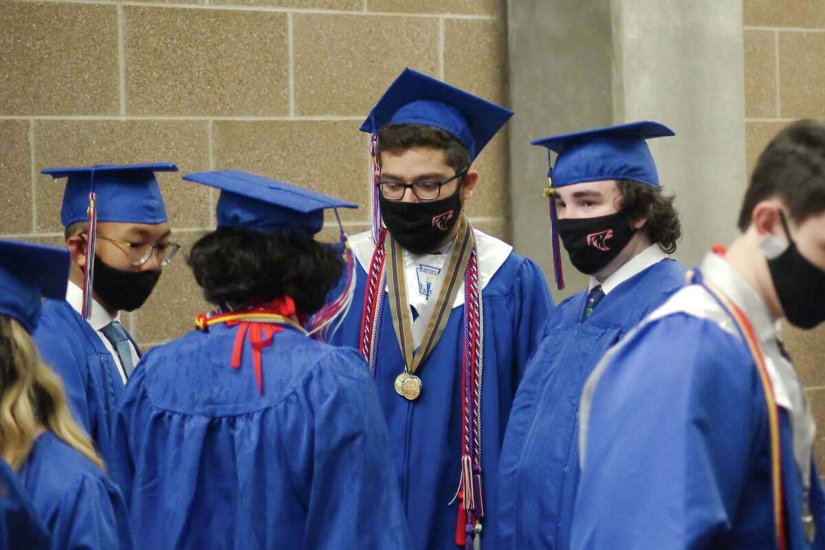 Seniors from Clear Lake High School's Class of 2020 wait to begin their graduation ceremony last May. Graduates in Clear Creek and Friendswood school districts are counting the days until they walk across the stage next month.