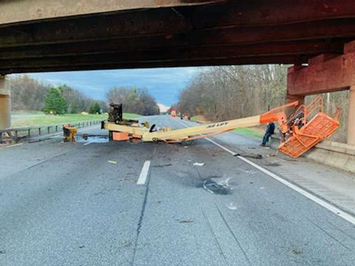 State officials said this boom lift hit the Northway overpass atSitterlyRoad in Clifton Park Wednesday morning, forcing State Police to close the highway for hours.