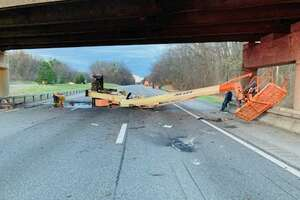 State officials said this boom lift hit the Northway overpass above Sitterly Road in Clifton Park Wednesday morning, forcing State Police to close the highway for hours.