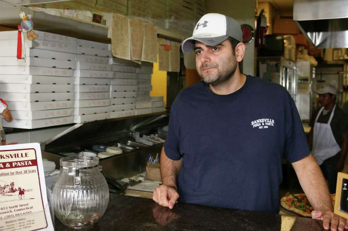 Banksville Pizza and Pasta owner Alfonso Criscuolo discusses business closures in the North Street Shopping Center and Banksville area at his pizza shop Friday, Sept. 10, 2010.