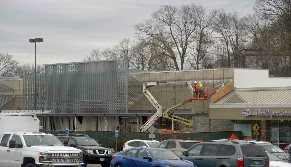 Construction on a store front in the Candlewood Plaza Shopping Center, 14 Candlewood Lake Road, in Brookfield, Conn. Monday, April 12, 2021.