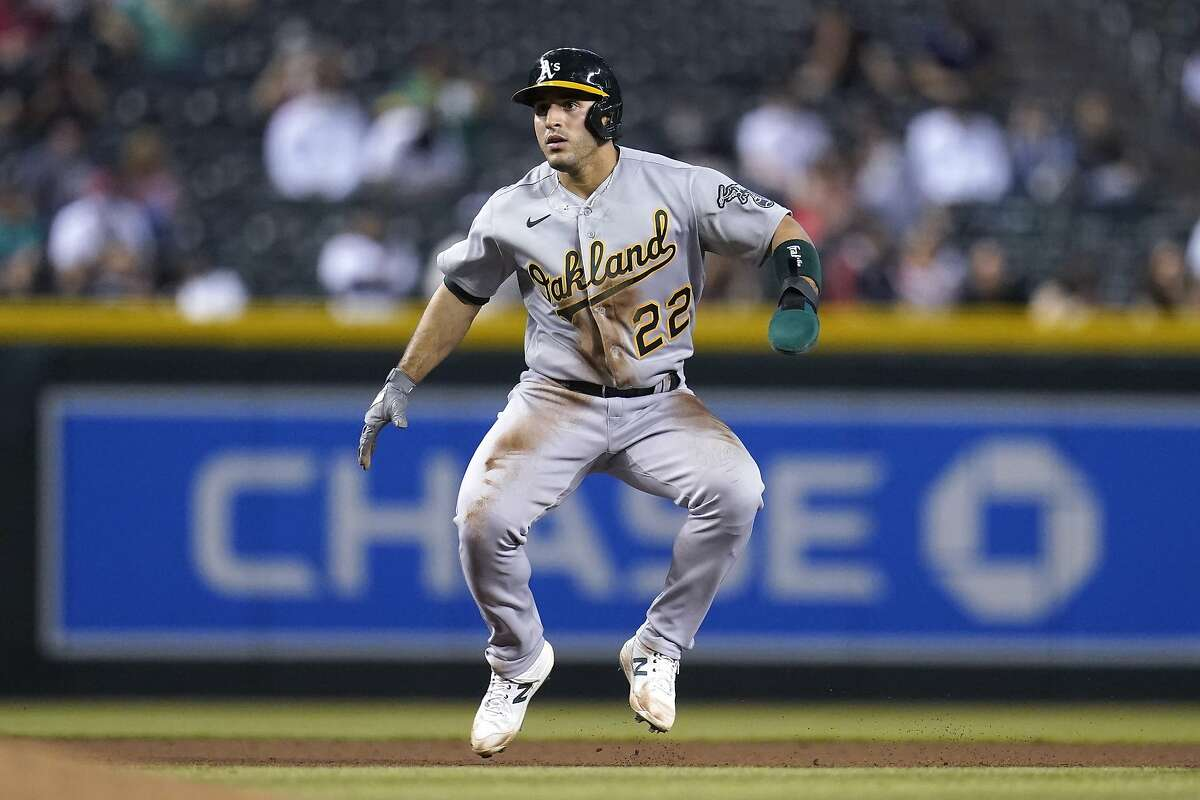 Oakland Athletics' Ramon Laureano takes a lead off from second base during the seventh inning of a baseball game against the Arizona Diamondbacks Monday, April 12, 2021, in Phoenix. (AP Photo/Ross D. Franklin)