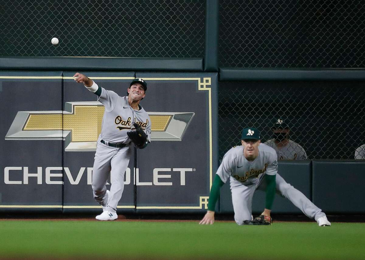 Oakland Athletics Ramon Laureano (22) makes a throw on Houston Astros Yordan Alvarez's double during the fourth inning of the Astros home opener MLB baseball game at Minute Maid Park, in Houston, Thursday, April 8, 2021.