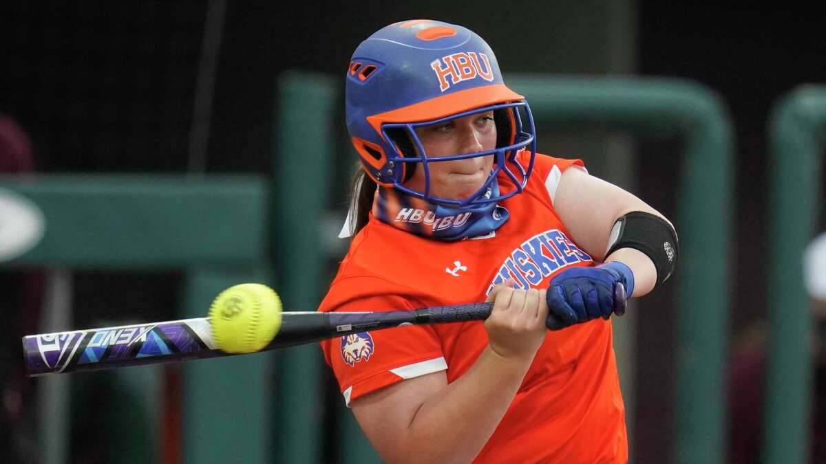 Houston Baptist utility fielder Autumn Sydlik (11) swings at the pitch while batting during an NCAA softball game on Tuesday, March 16, 2021, in College Station, Texas. (AP Photo/Matt Patterson)