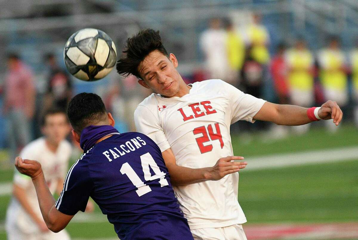 Julian Sanchez of LEE attempts a shot on goal with his head as Cristian Ugalde of Jersey Village defends during the Class 6A state semifinal in Georgetown on Tuesday, April 13, 2021. LEE won, 2-0.