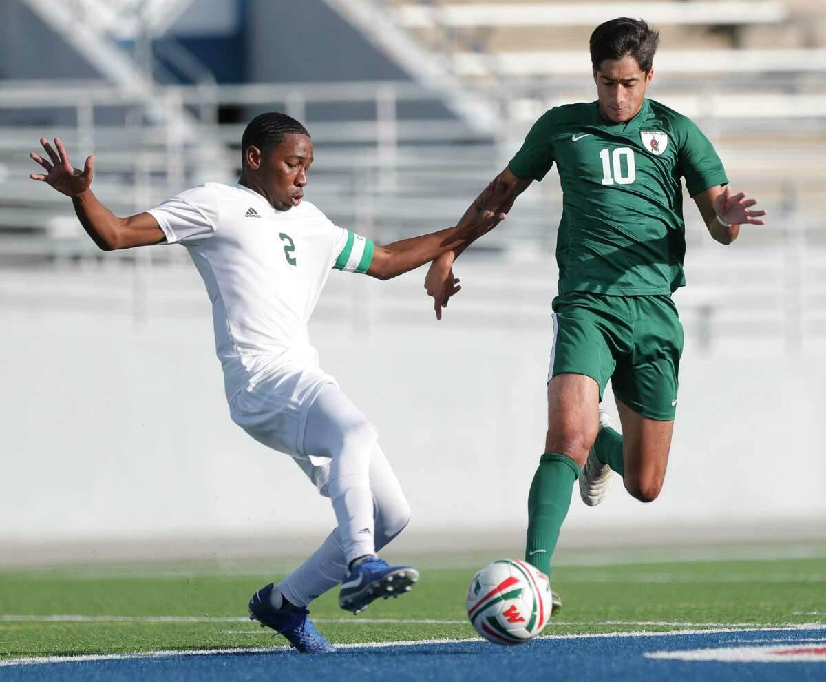 The Woodlands midfielder Hasan Arif (10) battles for the ball against Sharpstown midfielder Jostin Garcia Lagos (2) during the first period of a match during the Kilt Cup soccer tournament, Friday, Jan. 8, 2021, in Shenandoah.