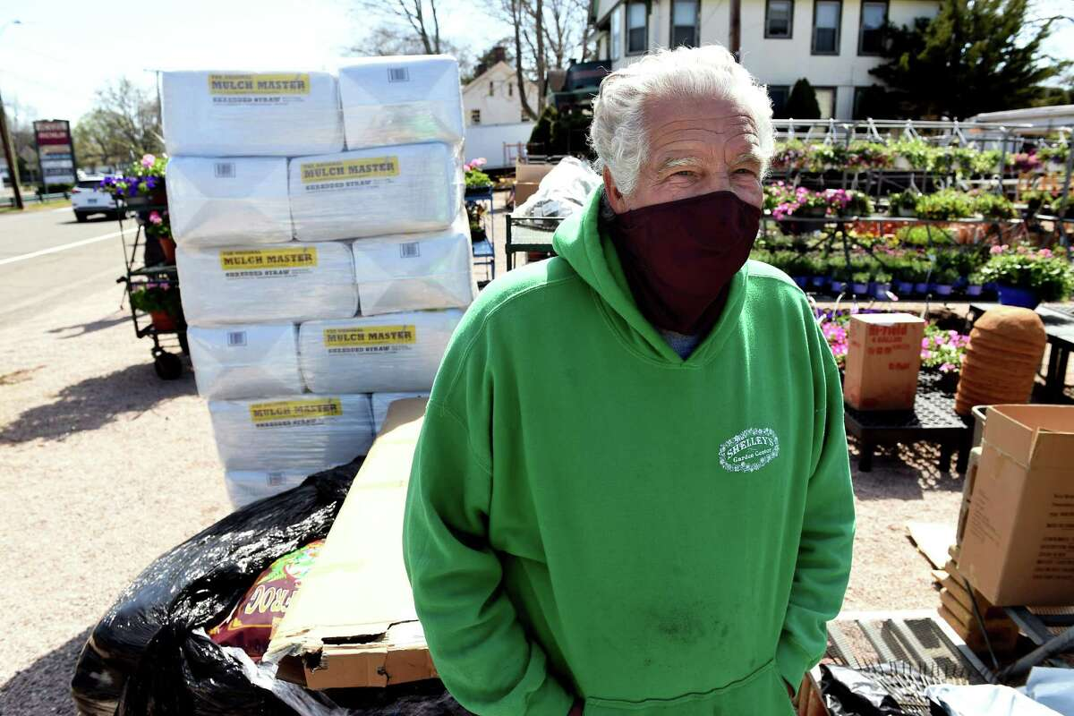 John Chambers, owner of Shelley's Garden Center. Behind him is the building from where a shooter fired during a standoff with police Tuesday.