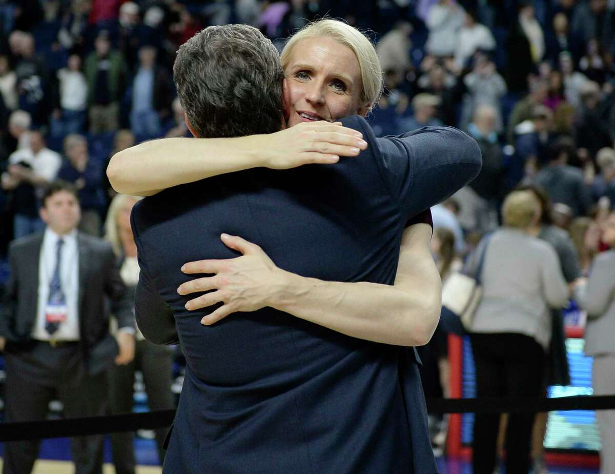 UConn assistant coach Shea Ralph embraces Geno Auriemma after the Huskies defeated Texas in the regional final of the NCAA tournament in Bridgeport in 2016.