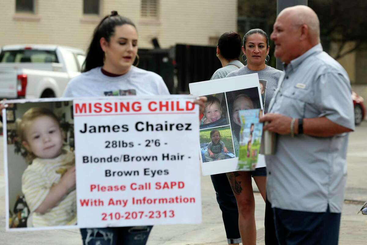 Jasmine Anderson, founder of KJ's Angels, stands in front of the Bexar County Courthouse in this file photo, holding a poster with information about missing toddler James Avi Chairez.