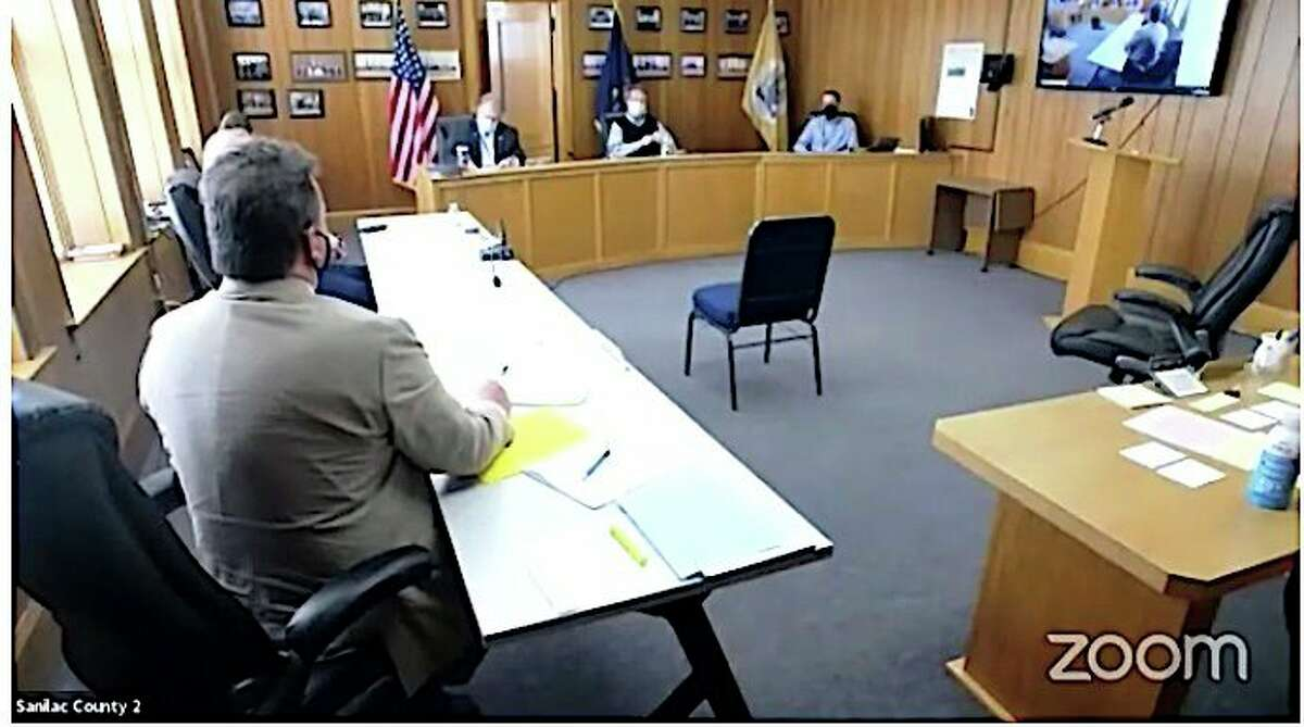 With masks on and six feet of space between them, Sanilac County Commissioners approved a declaration of emergency at their last meeting. The declaration allows for virtual meetings. (Mary Drier/For the Tribune)