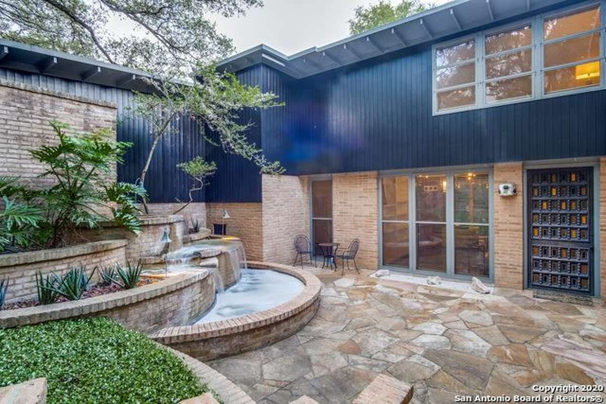 150 MOUNT ERIN PASS$1,595,0003 beds, 3 bathsThis is a hillside home with a hidden vault, elevator, and a cascading fountain.