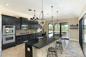 6701 LAURA HEIGHTS $599,000 5 bedrooms 5 full baths The swimming pool comes with a cascading fountain that invites you for a late night swim.