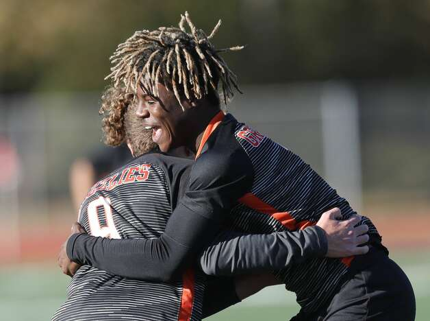 Grand Oaks' Ramiere Johnson, right, hugs Omar Younes after Younes' goal in the first period of a soccer match during the Humble ISD Bayou City Classic at Atascocita High School, Friday, Jan. 15, 2021, in Atascocita. Photo: Jason Fochtman/Staff Photographer / 2021 © Houston Chronicle