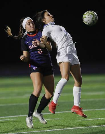 New Caney midfielder Isabel Silva (8) uses her body to control the ball against Grand Oaks defender Gisellie Francis (8) during the first period of a non-district high school soccer match at Grand Oaks High School, Friday, Jan. 22, 2021, in Spring. Photo: Jason Fochtman/Staff Photographer / 2021 © Houston Chronicle