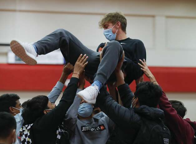 Lucas Hickey is lifted into the air by his teammates after signing to play soccer for Ohio Northern University during a National Signing Day ceremony at Oak Ridge High School, Wednesday, Feb. 3, 2020. Photo: Jason Fochtman/Staff Photographer / 2021 © Houston Chronicle