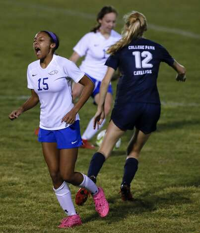Oak Ridge'€™s Raven Lewis (15) reacts after colliding with College Park's Carli Rabson (12) during the second period of a District 13-6A high school soccer match at College Park High School, Tuesday, Feb. 23, 2021, in The Woodlands. Photo: Jason Fochtman/Staff Photographer / 2021 © Houston Chronicle