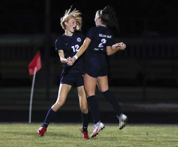 College Park'€™s Carli Rabson (12) reacts with Ashely Washburn (2) after scoring a goal during the first period of a District 13-6A high school soccer match at College Park High School, Tuesday, Feb. 23, 2021, in The Woodlands. Photo: Jason Fochtman/Staff Photographer / 2021 © Houston Chronicle