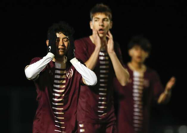 Magnolia West's Saul Flores (7) and Lukas Lopez (15) react after not getting a hand-ball call inthe box during the second period of a District 19-5A high school soccer match at Magnolia West High School, Wednesday, March 10, 2021, in Magnolia. Katy Paetow defeated Magnolia Wst 2-1. Photo: Jason Fochtman/Staff Photographer / 2021 © Houston Chronicle