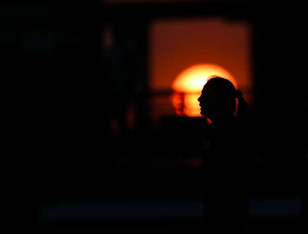 The sun sets during the second period of a bi-district high school soccer match between Lake Creek and Magnolia, Friday, March 26, 2021, in Waller. Photo: Jason Fochtman/Staff Photographer / 2021 © Houston Chronicle