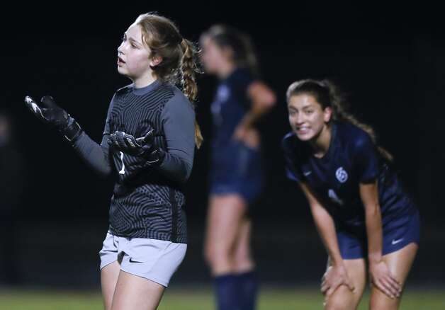 College Park goalie Grace Wilks (1) looks for an interference call after allowing a goal during the first period of a District 13-6A high school soccer match at College Park High School, Friday, March 19, 2021, in The Woodlands. Photo: Jason Fochtman/Staff Photographer