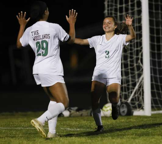 The Woodlands forward Katherine Williams (3) celebrates her third goal of the second period with forward Samone Knight (29) during a District 13-6A high school soccer match at College Park High School, Friday, March 19, 2021, in The Woodlands. Photo: Jason Fochtman/Staff Photographer