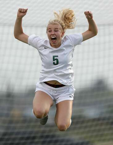 The Woodlands midfielder Courtney Koehler (5) reacts after scoring a goal during the first period of a high school girls soccer playoff match at Klein Oak High School, Tuesday, March 30, 2021, in Spring. Photo: Jason Fochtman/Staff Photographer / 2021 © Houston Chronicle
