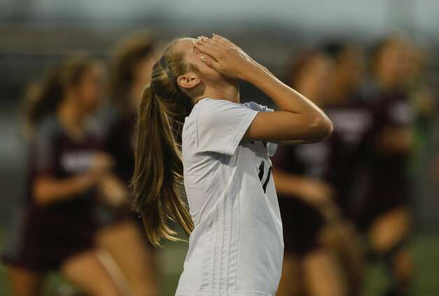 Lake Creek'€™s Avery Bowers (11) reacts after Magnolia's Sara Giannotti first of three goals during the second period of a bi-district high school soccer match, Friday, March 26, 2021, in Waller. Photo: Jason Fochtman/Staff Photographer / 2021 © Houston Chronicle