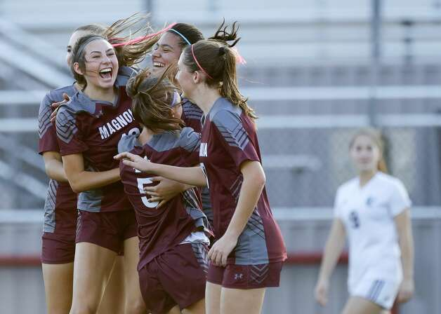 Magnolia players celebrate after Gaby Palomino's header tied the match 1-1 during the first period of a bi-district high school soccer match, Friday, March 26, 2021, in Waller. Photo: Jason Fochtman/Staff Photographer / 2021 © Houston Chronicle