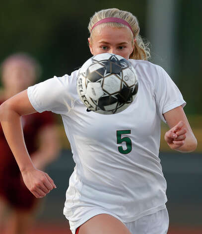 The Woodlands'€™ Courtney Koehler (5) chases down a loose ball during the first period of a high school girls soccer playoff match at Klein Oak High School, Tuesday, March 30, 2021, in Spring. Photo: Jason Fochtman/Staff Photographer / 2021 © Houston Chronicle