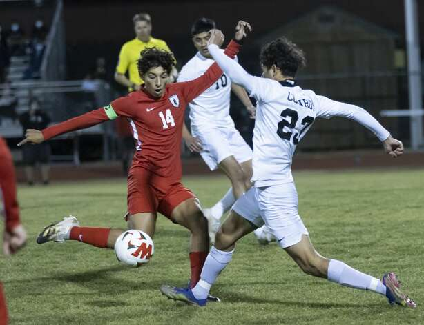 The Woodlands midfielder Tomas Cabrales (14) and Conroe Julian Vega (23) fight for control of the ball during the first half of a District 13-6A boys soccer at The Woodlands High School, Tuesday, Feb. 23, 2021, in The Woodlands. Photo: Gustavo Huerta/Staff Photographer / Houston Chronicle © 2021
