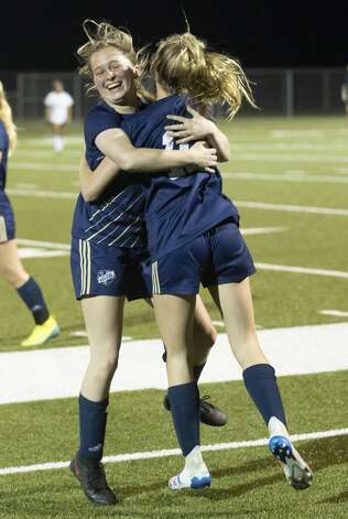 Lake Creek midfielder Camryn Robbins (1) and Lake Creek Gracie Wiley (10) embrace one another after winning 3-0 against Caney Creek during a District 20-5A girls soccer game at Lake Creek High School, Friday, March 12, 2021, in Montgomery. Lake Creek will be heading to the playoffs after their win against Caney Creek. Photo: Gustavo Huerta/Staff Photographer / Houston Chronicle © 2021