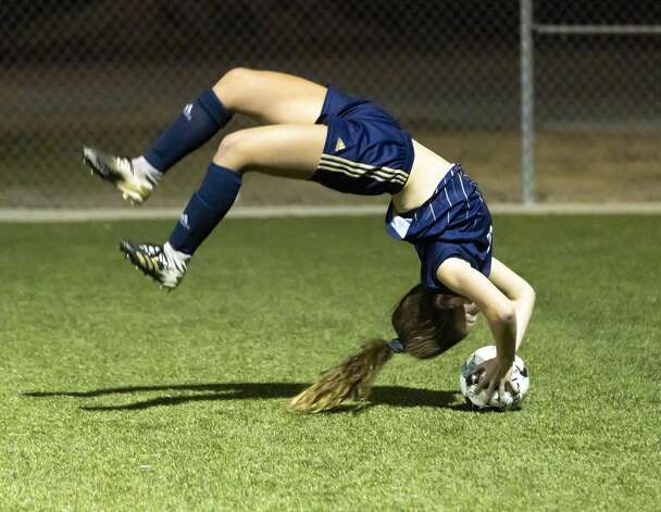 Lake Creek Kate Coleman (12) does a cartwheel as she throws in the ball during the second half of a District 20-5A girls soccer game against Caney Creek at Lake Creek High School, Friday, March 12, 2021, in Montgomery. Photo: Gustavo Huerta/Staff Photographer / Houston Chronicle © 2021