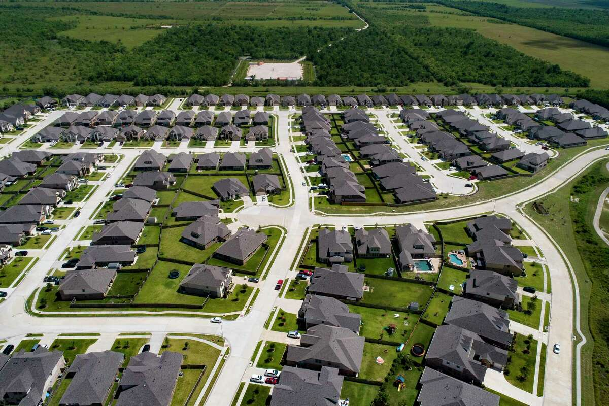 A subdivision in League City. As the economy improves, many who had paused payments on their mortgages have been able to resume.