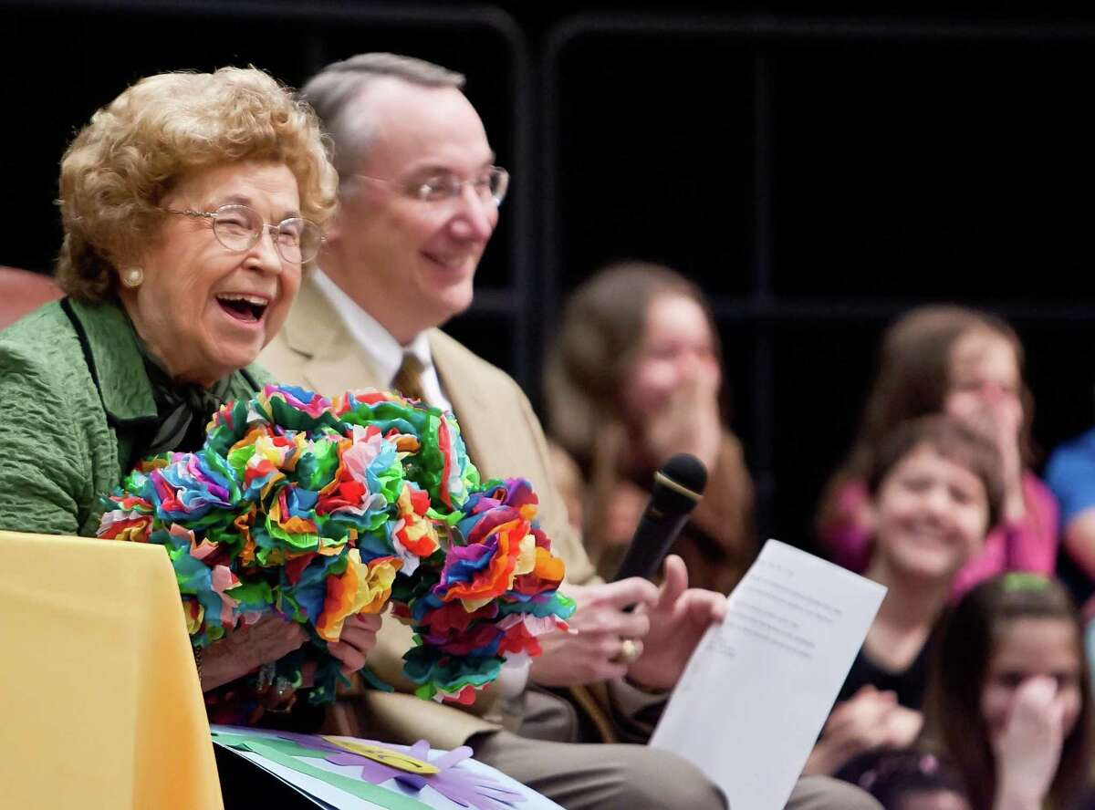 Bonnie Wilkinson, left, laughs with students after receiving a bouquet of paper flowers from students at Bonnie Wilkinson Elementary School in Conroe. Wilkinson died in April at age 91. Now her former teachers at Giesinger Elementary are collecting funds to have a bust of her installed in the school.
