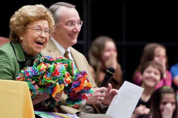 Bonnie Wilkinson laughs with students after receiving a bouquet of paper flowers from students at Bonnie Wilkinson Elementary School in Conroe. Wilkinson celebrated her 80th birthday with students at the school. She died on April 6 at age 91.