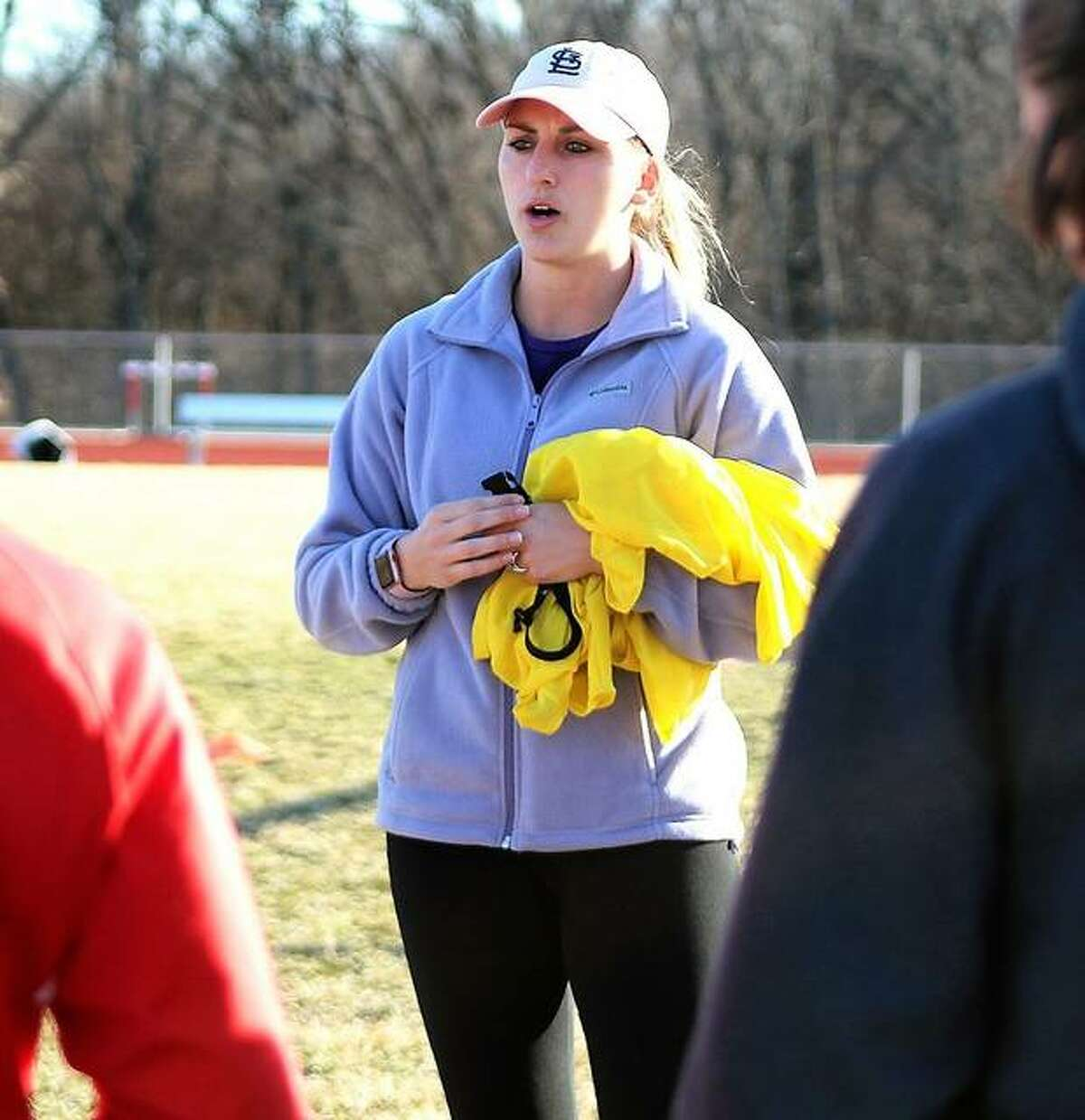 Alton girls soccer coach Gwen Sabo speaks to her players during a 2020 preseason practice at AHS. The season never started, however, after the IHSA pulled the plug on spring sports because of the coronavirus pandemic.