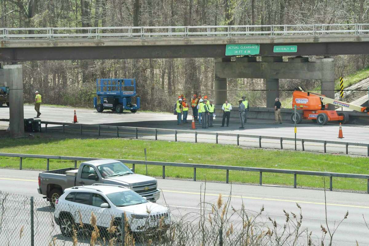 A view of the Sitterly Road overpass above Interstate 87 on Wednesday, April 14, 2021, in Clifton Park, N.Y. A truck towing a trailer with a boom lift and traveling south on I-87, struck the bridge Wednesday morning, resulting in all lanes of I-87 southbound to be shut down to traffic. (Paul Buckowski/Times Union)