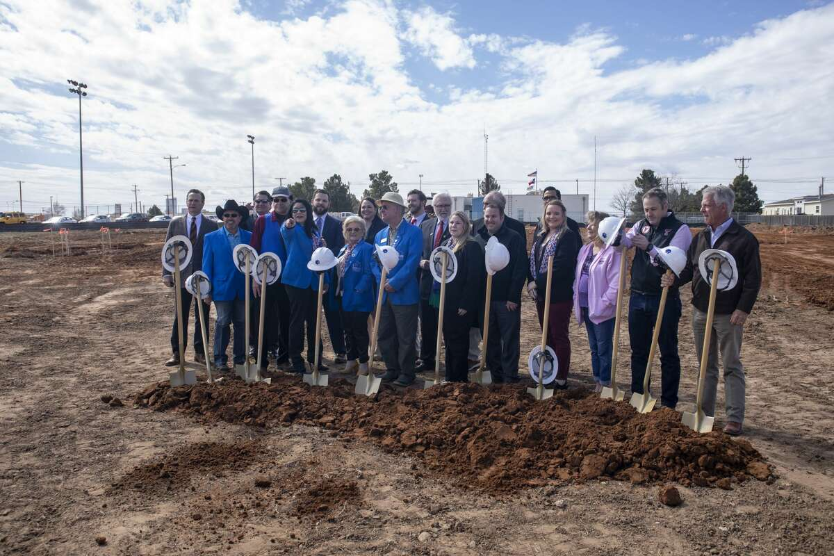 Members of the city council and Midland Chamber of Commerce pose for a picture after the groundbreaking of the new Animal Services facility on Feb. 25, 2020 behind Midland Animal Control.