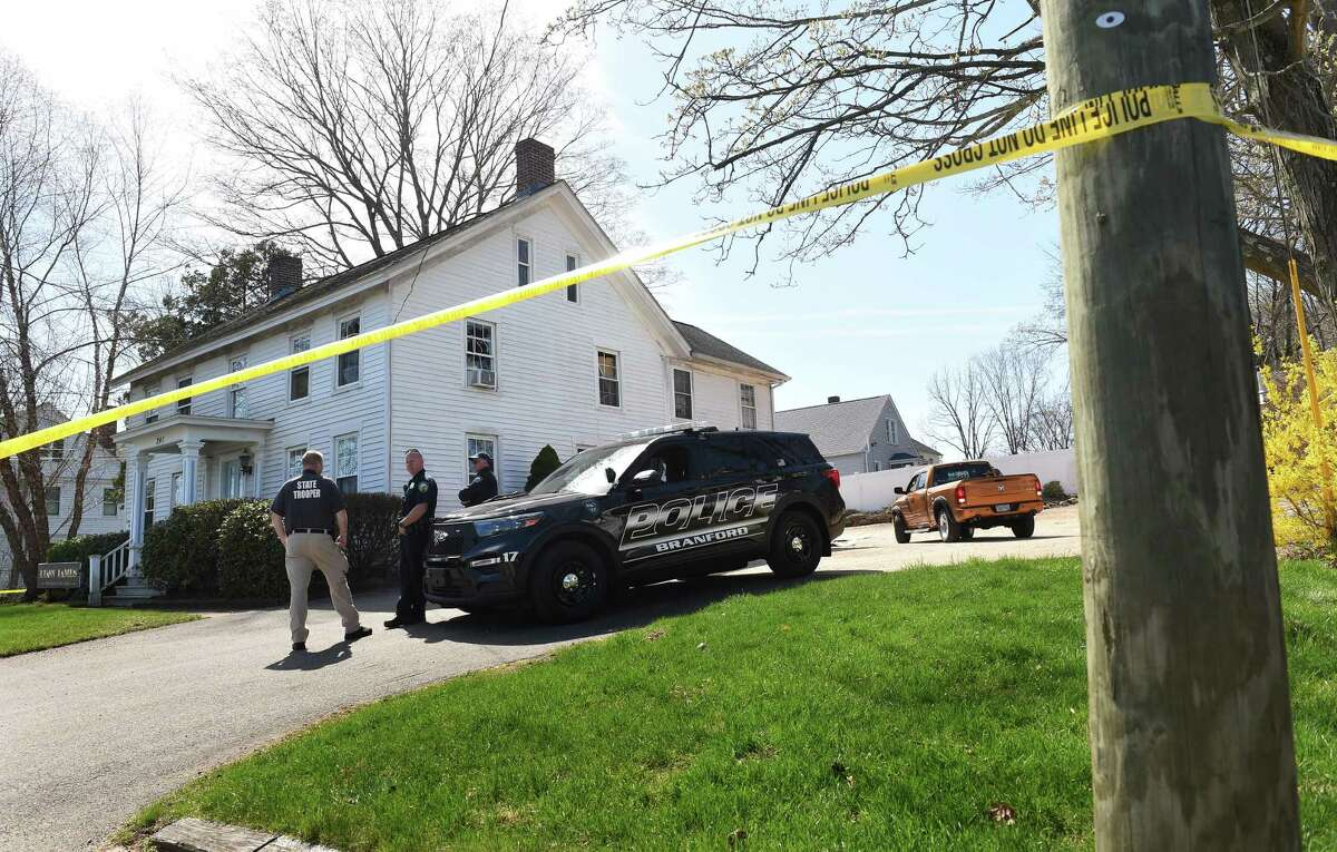 Branford Police investigate at 241 Main St. on April 14, 2021, where they engaged fire with a shooter in a second-floor apartment the previous day.