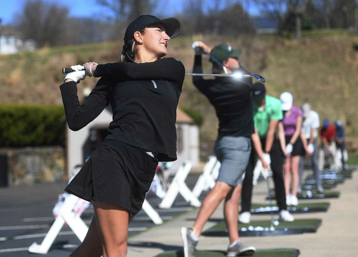 From left, Hamden Hall golf team standouts Sophia Sarrazin, Jackson Roman, and Ben James hit the driving range during team practice at Great River Country Club in Milford on April 7.