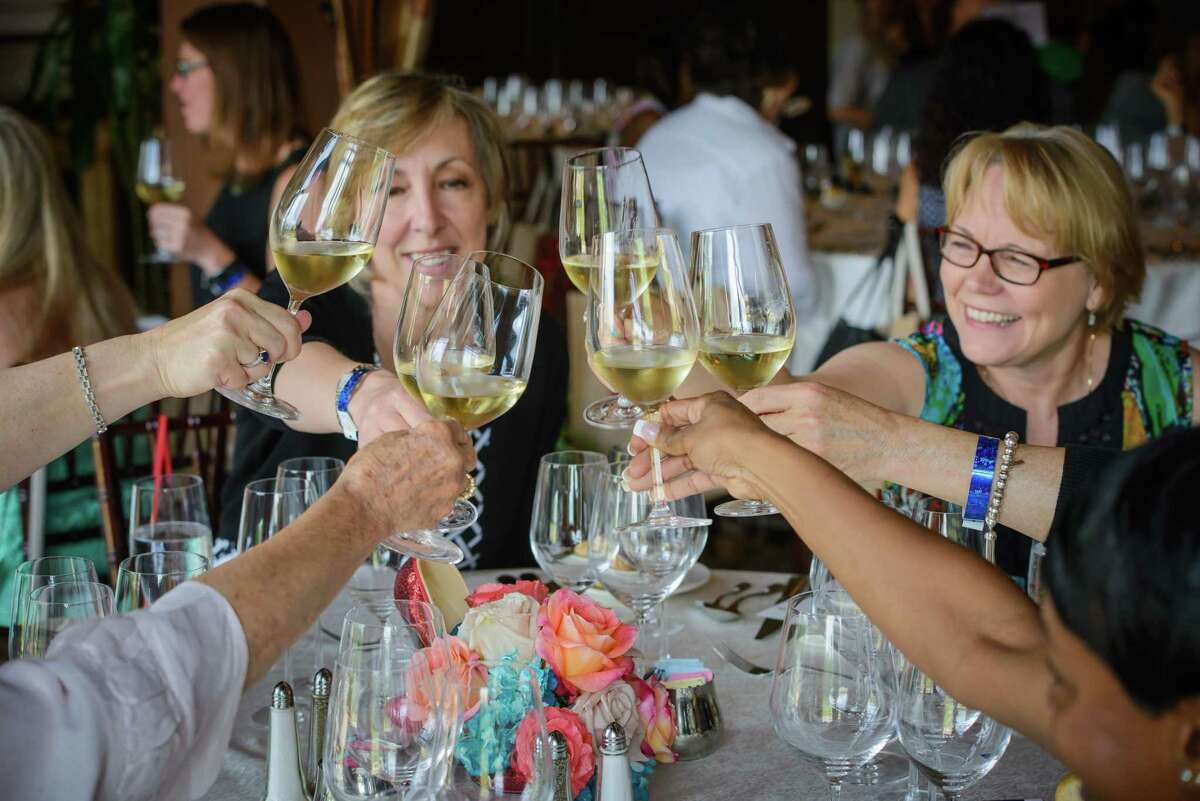 Participants of a previous Ladies of the Vine as a part of Wine & Food Week in The Woodlands. This year's event is set for May 21 at The Club at Carlton Woods.