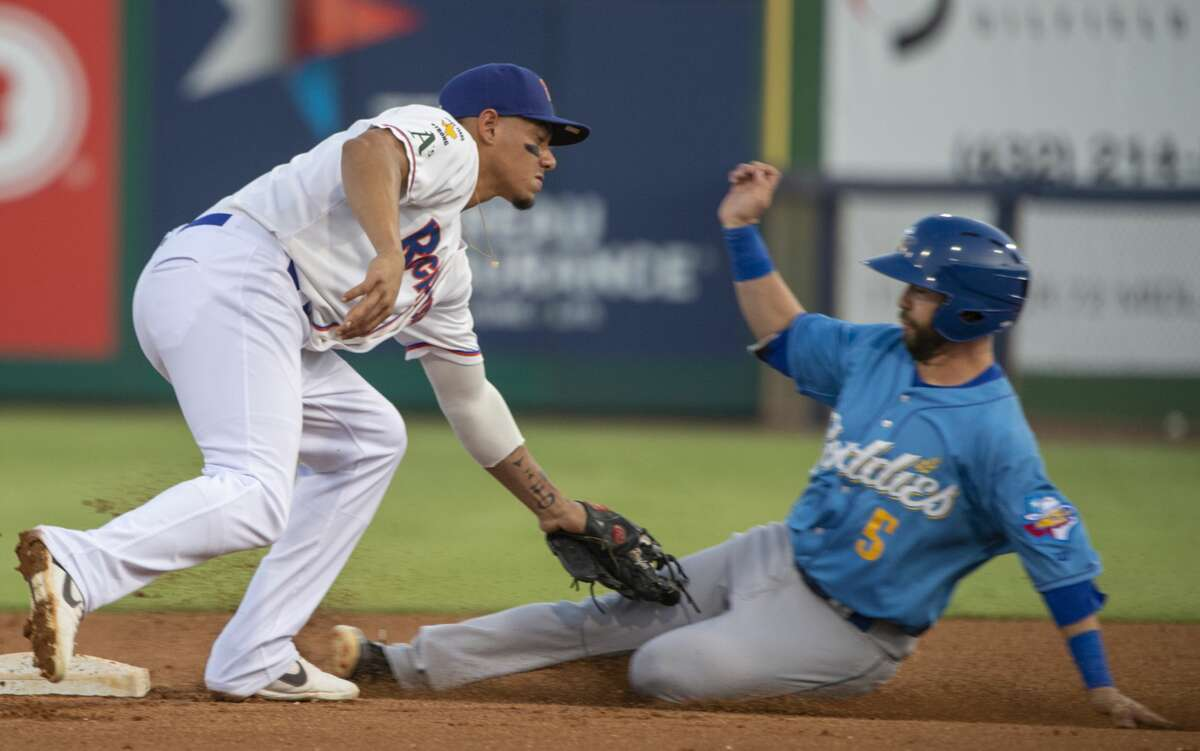 RockHounds' Edwin Diaz puts the tag on Amarillo's Pater Van Gansen as he tries to steal second Sept. 7, 2019 in game 4 of the Texas League Division playoff.